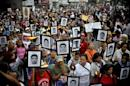 Less than two years ago the parents of 43 missing students would have been surrounded by thousands of people when they marched, but only a few hundred turned out this time in Mexico City