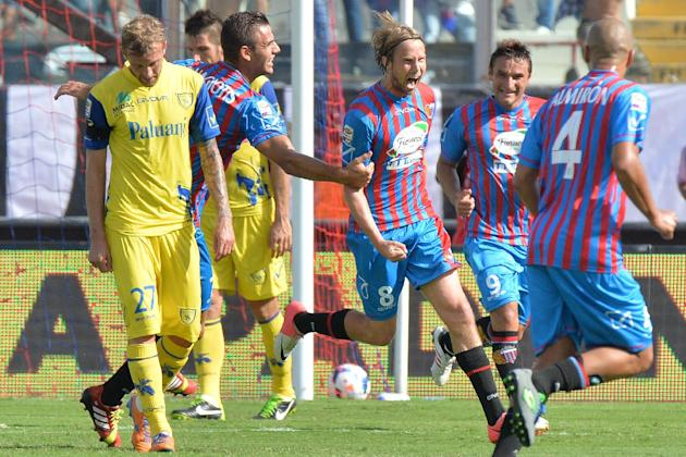 Catania's Jaroslav Plasil, of Czech Republic, center, celebrates after scoring during the Serie A soccer match between Catania and Chievo Verona at the Angelo Massimino stadium in Catania, Italy, Sund