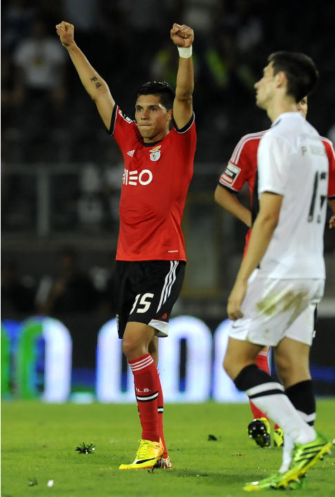 Benfica's Enzo Perez, from Argentina, celebrates their 1-0 victory over Vitoria Guimaraes in a Portuguese League soccer match at D. Afonso Henrique stadium in Guimaraes, Portugal, Sunday, Sept. 22, 20