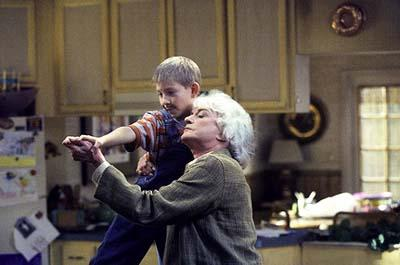 "Dewey (Erik Per Sullivan, L) and his babysitter (Bea Arthur, R) give new meaning to ""it takes two to tango"" in the ""Water Park"" episode of Fox's Malcolm In The Middle"