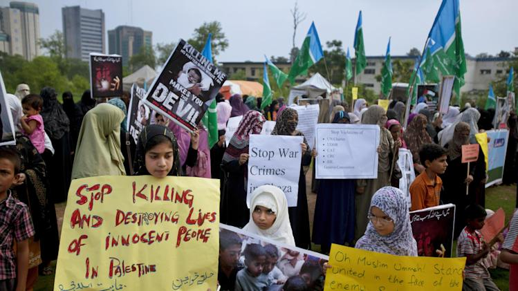 Pakistani children and women supporters of Jamaat-e-Islami take part in a demonstration against the Israeli bombings in the Gaza strip, in Islamabad, Pakistan, Saturday, July 26, 2014. Thousands of Gaza residents who had fled Israel-Hamas fighting streamed back to devastated border areas during a lull Saturday to find large-scale destruction: scores of homes were pulverized, wreckage blocked roads and power cables dangled in the streets. (AP Photo/Anjum Naveed)