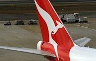 Qantas plane is seen at the Sydney International Airport, on August 22, 2012. Australian flag carrier on Thursday announced a doubling of first half net profit to Aus$111 million