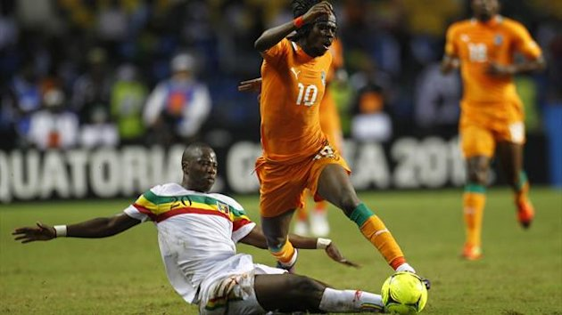 Ivory Coast's Gervinho (10) is fouled by Mali's Samba Diakite during their African Nations Cup semi-final (Reuters)