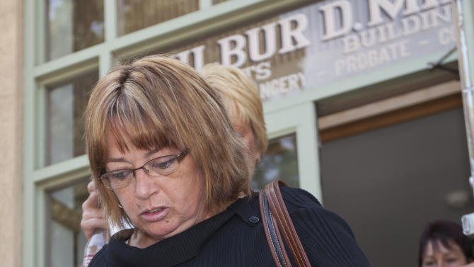 Sharon Duncan, one of three women involved in a lawsuit over a $1 million lottery ticket, leaves the Wilber D. Mills Court Building during a break in Searcy, Ark., Tuesday, May 1, 2012. (AP Photo/Danny Johnston)