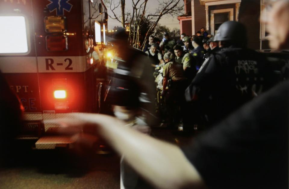 In this Friday, April 19, 2013 Massachusetts State Police photo, 19-year-old Boston Marathon bombing suspect Dzhokhar Tsarnaev is placed into an ambulance by medical personnel following his capture by law enforcement authorities in Watertown, Mass. (AP Photo/Massachusetts State Police, Sean Murphy)
