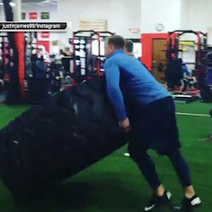 Houston Texans defensive end J.J. Watt lifts 1,000-pound tire during workout
