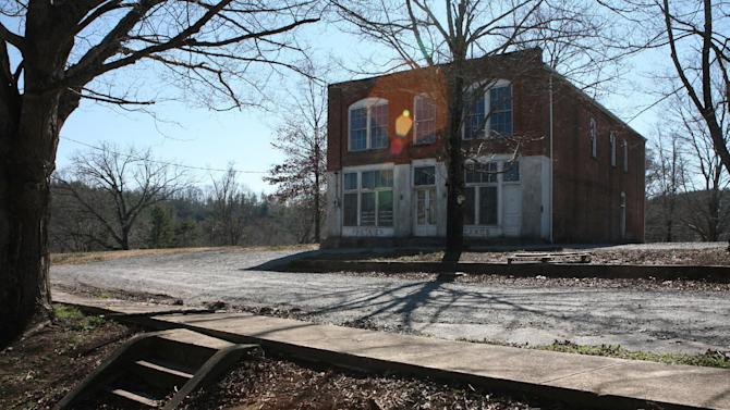 "This undated image provided by VisitNC.com shows an old company store at the abandoned Henry River Mill Village in Hildebran, N.C., where scenes from ""The Hunger Games"" were shot. In the movie, the store became the Mellark family bakery in District 12. (AP Photo/VisitNC.com, Margo Metzger)"