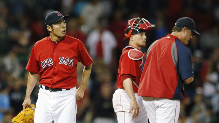Boston Red Sox's Koji Uehara, left, walks to the dugout after being taken out by manager John Farrell, right, during the ninth inning of a baseball game against the Seattle Mariners in Boston, Friday, Aug. 22, 2014. Red Sox catcher Christian Vazquez, center, looks on. The Mariners won 5-3. (AP Photo/Michael Dwyer)