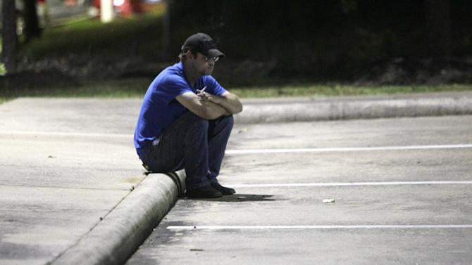 Keith Schuchardt sits outside the Conroe Police Department  in Conore, Texas, early Wednesday, April 18, 2012 after learning he would not be reunited right away with his  3-day-old son, Keegan Schuchardt. The baby was abducted from his wife, Kala Marie Golden, in the parking lot of a medical clinic on Tuesday. Kala was shot by the abductor and later died at the hospital. Keegan, was found unharmed Tuesday evening. The family went to the police dept. in hopes of picking up Keegan, but were told they would have to wait for background checks before the baby could be released. ( AP Photo/Houston Chronicle, Melissa Phillip)  MANDATORY CREDIT