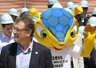 FIFA's secretary-general, Jerome Valcke stands near the armadillo, the mascot for the 2014 World Cup, during a visit to the Magalhaes Pinto stadium in Brazil, on October 16. Valcke has left a Rio hospital, four days after being admitted for treatment of a urinary infection