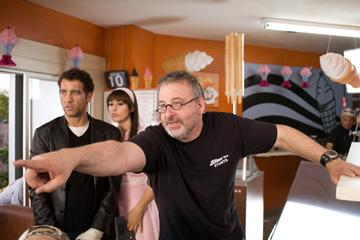 Clive Owen , Monica Bellucci and director Michael Davis on the set of New Line Cinema's Shoot 'Em Up