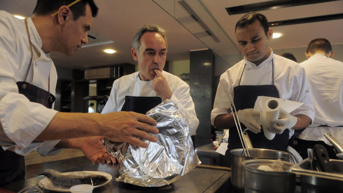 FILE - This March 30, 2011 file photo shows Spanish chef Ferran Adria as he tastes some food in the kitchen of his restaurant elBulli in Roses, Spain.  Only the very, very luckiest of eaters will ever be able to say they ate at elBulli, Ferran Adria's insanely inventive restaurant in Spain where dinner can be up to 50 palette-bending courses _ especially because it closes on July 30.   (AP Photo/Manu Fernandez, file)