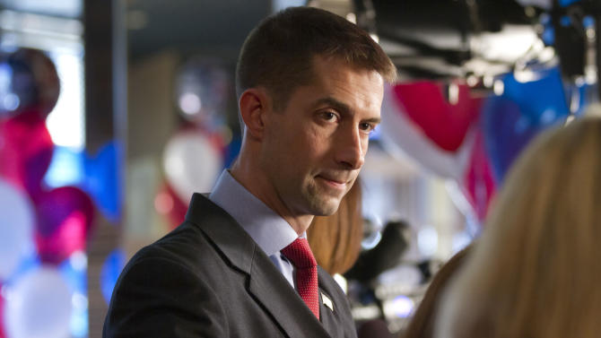 """FILE - In this Tuesday, May 22, 2012 file photo, Tom Cotton is interviewed before his election night watch party in Hot Springs, Ark. Cotton, the Republican nominee in Arkansas' 4th Congressional District race, compared his decision to run with his decision to join the Army in 2005. """"At that time, it was an attack from a foreign enemy, and we were in an active war. And now we're in a debt crisis that threatens our future prosperity and, therefore, ultimately freedom,"""" says Cotton, 35, who declined a commission as a legal officer to go into the infantry. (AP Photo/Danny Johnston)"""
