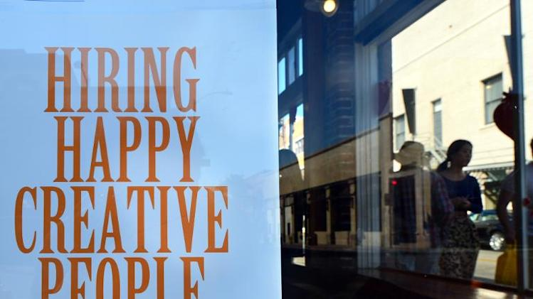 A job sign is seen on a shopfront window on October 22, 2013 in Pasadena, California