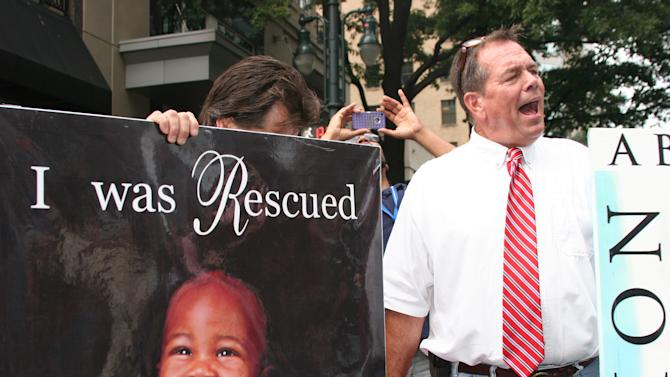 A pro-life supporter draws a crowd as he expresses his views in downtown Charlotte, N.C. on Tuesday Sept. 4, 2012. (Torrey AndersonSchoepe/Yahoo! News)