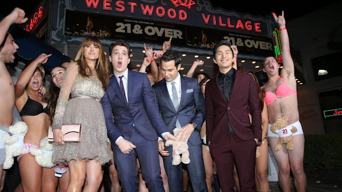 """Sarah Wright, Miles Teller, Skylar Astin and Justin Chon at the LA premiere of """"21 and Over"""" at the Westwood Village Theatre on Thursday, Feb. 21, 2013 in Los Angeles. (Photo by Eric Charbonneau/Invision/AP)"""