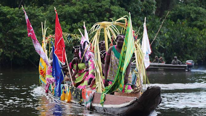 Competitors in the Beautiful Boat competition navigate the Cottica River in Moengo