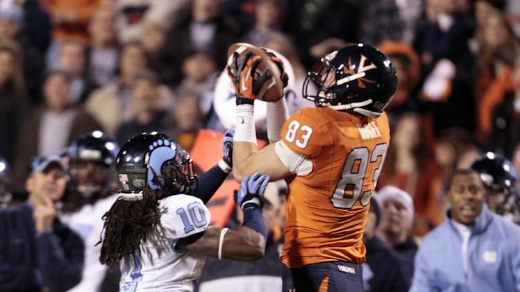 Virginia tight end Jake McGee (83) catches a pass in front of North Carolina safety Tre Boston (10) during the first half of an NCAA college football game at Scott stadium  Thursday, Nov. 15, 2012 in Charlottesville, VA (AP Photo/Steve Helber)