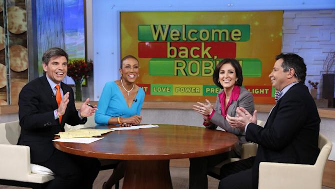 """This image released by ABC shows anchors George Stephanopoulos, from left, and Robin Roberts with Dr. Gail Roboz and Dr. Sergio Giralt during a broadcast of """"Good Morning America,"""" Wednesday, Feb. 20, 2013 in New York.  Roberts returned to the popular morning program after undergoing a bone marrow transplant five months ago.  (AP Photo/ABC, Heidi Gutman)"""