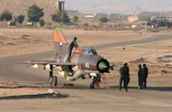 The Syrian air force Russian-made MiG-21 plane that a pilot landed in the King Hussein military base in northern Jordan, in a picture obtained from Ammon News and supplied by Syrian activists. The Syrian pilot was granted political asylum after landing his jet, in the first such defection of a revolt a watchdog says has killed more than 15,000 people