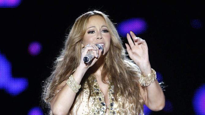 FILE - This May 26, 2012 file photo shows U.S. Singer Mariah Carey performing on stage during a concert at the Mawazine Festival in Rabat, Morocco. Carey will be honored as a BMI icon at the BMI Urban awards on Sept. 7, 2012 at the Saban Theatre in Beverly Hills, Calif. (AP Photo/Abdeljalil Bounhar, file)