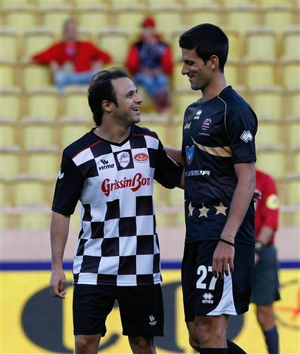 Novak Djokovic of Monaco of Star Team for the Children, right, and Felipe Massa of Formula One Drivers Team, react, during a charity soccer match against Formula One Drivers Team, at the Louis ll stad
