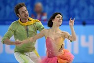 France's Nathalie Pechalat and France's Fabian Bourzat perform in the Figure Skating Ice Dance Free Dance at the Iceberg Skating Palace during the Sochi Winter Olympics on February 17, 2014