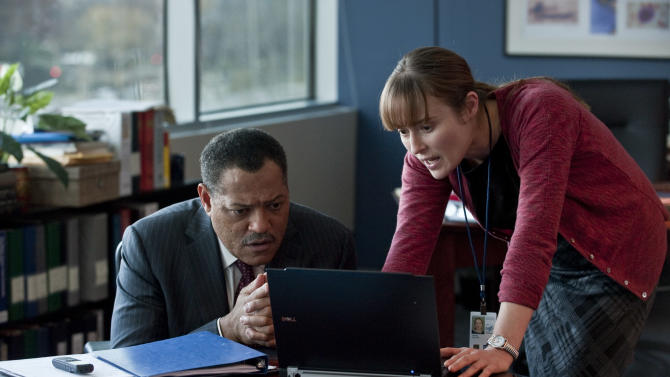 """In this image released by Warner Bros. Pictures, Laurence Fishburne, left, and Jennifer Ehle are shown in a scene from the film """"Contagion."""" (AP Photo/Warner Bros. Pictures, Claudette Barius)"""