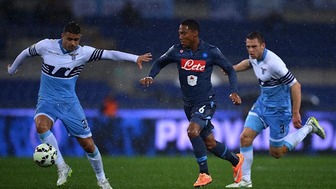 Napoli's Jonathan De Guzman (C) fights for the ball with Lazio's Danilo Cataldi (L) and Stefan de Vrij during their Italian Tim Cup football match on March 4, 2015 at the Olympic stadium in Rome