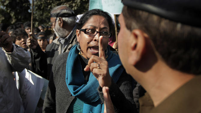An Indian protester argues with a police officer outside the Delhi Police headquarters as they block a main road during a protest in New Delhi, India, Wednesday, Dec. 19, 2012. The hours-long gang-rape and near fatal beating of a 23-year-old student on a bus in New Delhi triggered outrage and anger across the country Wednesday as Indians demanded action from authorities who have long ignored persistent violence and harassment against women. (AP Photo/Altaf Qadri)