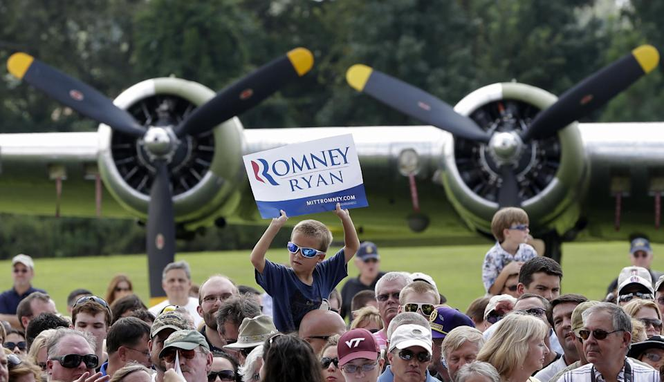 A boy waits for Republican presidential candidate Mitt Romney campaigns at the Military Aviation Museum in Virginia Beach, Va., Saturday, Sept. 8, 2012. (AP Photo/Charles Dharapak)
