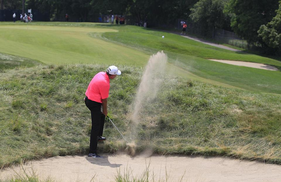 Lance Ten Broeck hits from the sand on the second hole during the third round at the U.S. Senior Open golf tournament at the Indianwood Golf and Country Club in Lake Orion, Mich., Saturday, July 14, 2012. (AP Photo/Carlos Osorio)