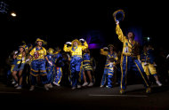"Members of the murga ""Los amantes de La Boca"" perform during carnival celebrations in Buenos Aires, Argentina, Sunday, Feb. 3, 2013. Argentina's carnival celebrations may not be as well-known as the ones in neighboring Uruguay and Brazil, but residents of the nation's capital are equally passionate about their ""murgas,"" or traditional musical troupes. The murga ""Los amantes de La Boca,"" or ""The Lovers of The Boca"" is among the largest, with about 400 members. It's a reference to the hometown Boca Juniors, among the most popular soccer teams in Argentina and the world. (AP Photo/Natacha Pisarenko)"