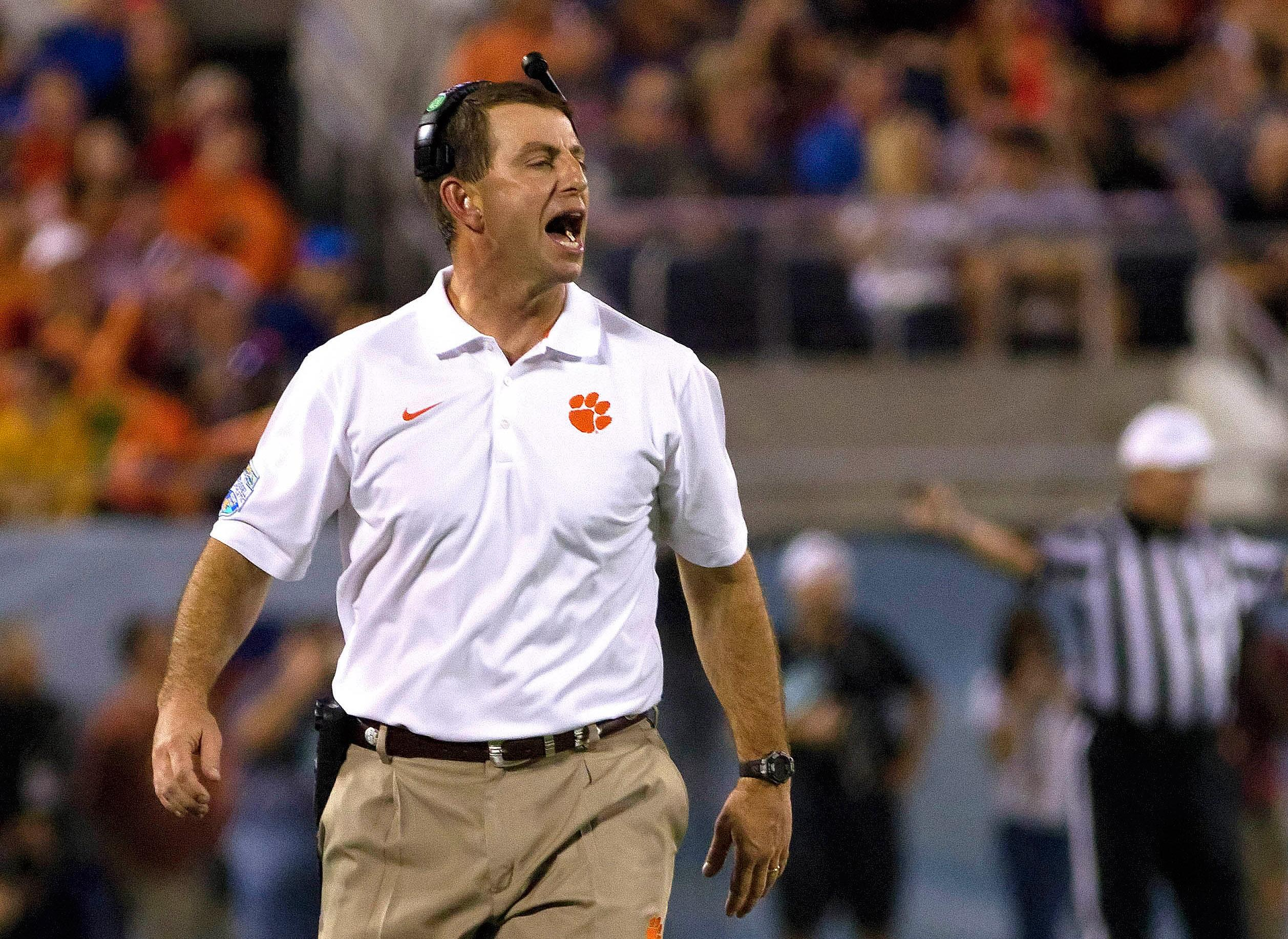 Clemson coach Dabo Swinney loves his moped anonymity
