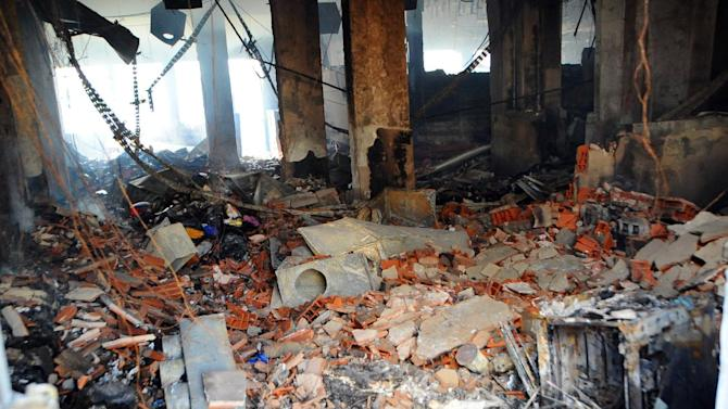 View of burned American school adjacent to the U.S. embassy compound in Tunis, Tunisia, Saturday, Sept. 15, 2012, a day after several thousand demonstrators angry over a film that insults the Prophet Muhammad stormed the compound. Tunisia's governing moderate Islamist party condemned the attacks, saying Saturday that such violence threatens the country's progress toward democracy after decades of dictatorship. (AP Photo/Hassene Dridi)