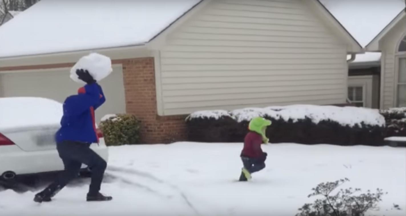 Kid doesn't stand a chance against dad's snowball