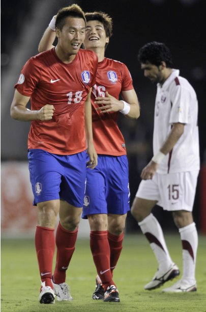 South Korea's Kim celebrates after scoring a goal against Qatar during their 2014 World Cup qualifying soccer match in Doha