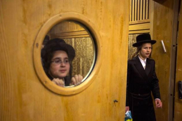 Ultra-Orthodox Jewish boys look at preparations for the wedding of the Chief Rabbi of Belz's grandson in Jerusalem