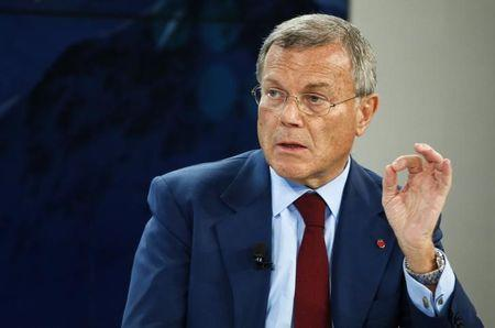 Sorrell, Chief Executive Officer of WPP, gestures during the session 'The BBC World Debate: A Richer World, but for Whom?' in the Swiss mountain resort of Davos