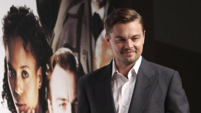"""FILE - In this March 2, 2013 file photo, actor Leonardo DiCaprio poses for a photo call during a press conference to promote his new film """"DJango Unchained"""" in Tokyo. Quentin Tarantino's violent slave-revenge movie """"Django Unchained"""" returned to Chinese theaters on Sunday, May 12, 2013 about a month after it was pulled on opening day for unspecified """"technical reasons."""" (AP Photo/Junji Kurokawa, File)"""