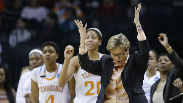 Tennessee head coach Holly Warlick gestures in the second half of the Oklahoma City regional final game in the women's NCAA college basketball tournament in Oklahoma City, Tuesday, April 2, 2013. Tennessee won 86-78. (AP Photo/Sue Ogrocki)