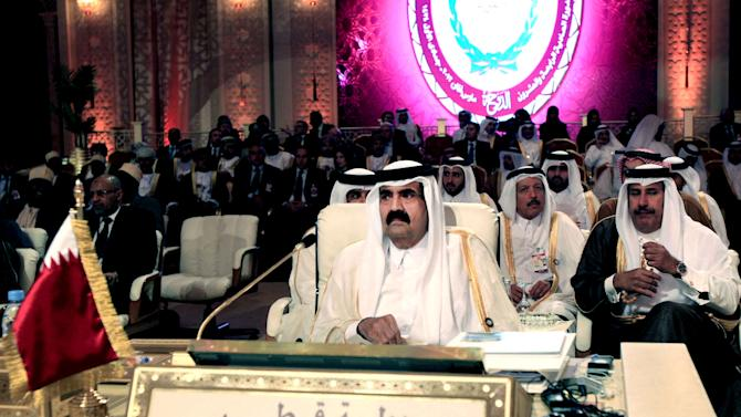 Qatar ruler hands power to son to mark 'new era'