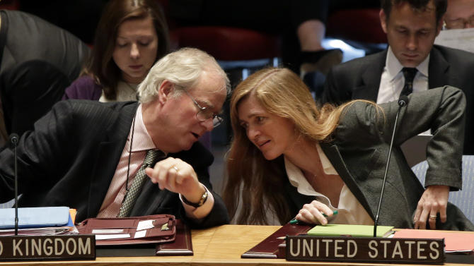 British Ambassador Mark Lyall Grant and U.S. Ambassador Samantha Power confer in the United Nations Security Council, Tuesday, Sept. 17, 2013. Moscow insisted on Tuesday that a new Security Council resolution on Syria not allow the use of force, while the Arab country's main opposition group demanded a swift international response following the U.N. report that confirmed chemical weapons were used outside Damascus last month. (AP Photo/Richard Drew)