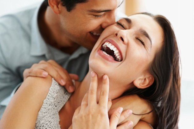 Young Couple Laughing and Kissing