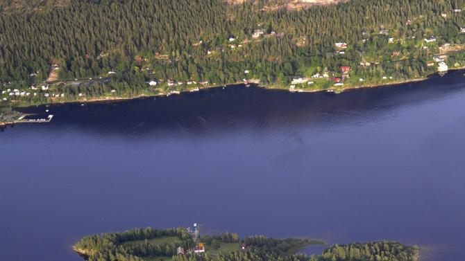 This is an aerial view of Utoya Island, Norway, taken Thursday, July 21, 2011. Police say they are sending anti-terror police to a youth camp outside Oslo after reports of a shooting there following the bomb blast at the government headquarters. The news site VG reported that a man dressed in a police uniform opened fire at the camp. It says several people were injured. Oslo police chief Anstein Gjengdal said anti-terror units were being sent to the camp at Utoya, outside the Norwegian capital. He had no other information on that incident, which came hours after a bomb blast outside the government headquarters killed at least two people and injured 15. (AP Photo/Mapaid, Lasse Tur)  NORWAY OUT