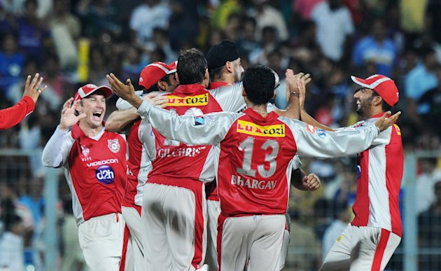 Kings XI Punjab players celebrate their
