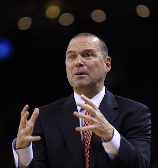 Sacramento Kings coach Michael Malone gestures during the first half of an NBA basketball game against the Golden State Warriors on Saturday, Nov. 2, 2013, in Oakland, Calif