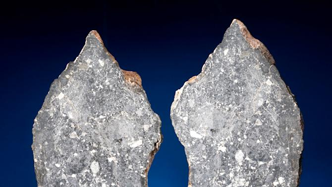 This undated photo provided by Heritage Auctions shows a large chunk of the moon, which will be offered at a sale in New York of more than 125 meteorites on Oct. 14, 2012. Found in Libya, it originates from the far side of the moon, and is estimated to bring $340,000 to $380,000.  (AP Photo/Heritage Auctions)