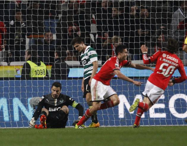 Benfica's Nicolas Gaitan celebrates his goal against Sporting with teammate Lazar Markovic near Sporting's goalkeeper Rui Patricio during their Portuguese Premier League soccer match at Luz st