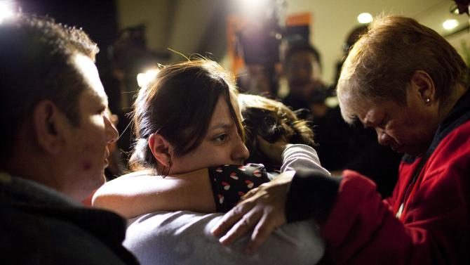 Family members of Jerzy Ortiz embrace after their after meeting with chief prosecutor Rodolfo Rios, in Mexico City, Tuesday, June 4, 2013. Jerzy Ortiz is one of a group of men and women who went missing on May 26, 2013 from a Mexico City bar. Another young woman has been added to the list of young people apparently abducted as a group from an after-hours bar in a normally calm district of Mexico City, raising the number of missing to 12, prosecutors said Tuesday night. (AP Photo/Ivan Pierre Aguirre)